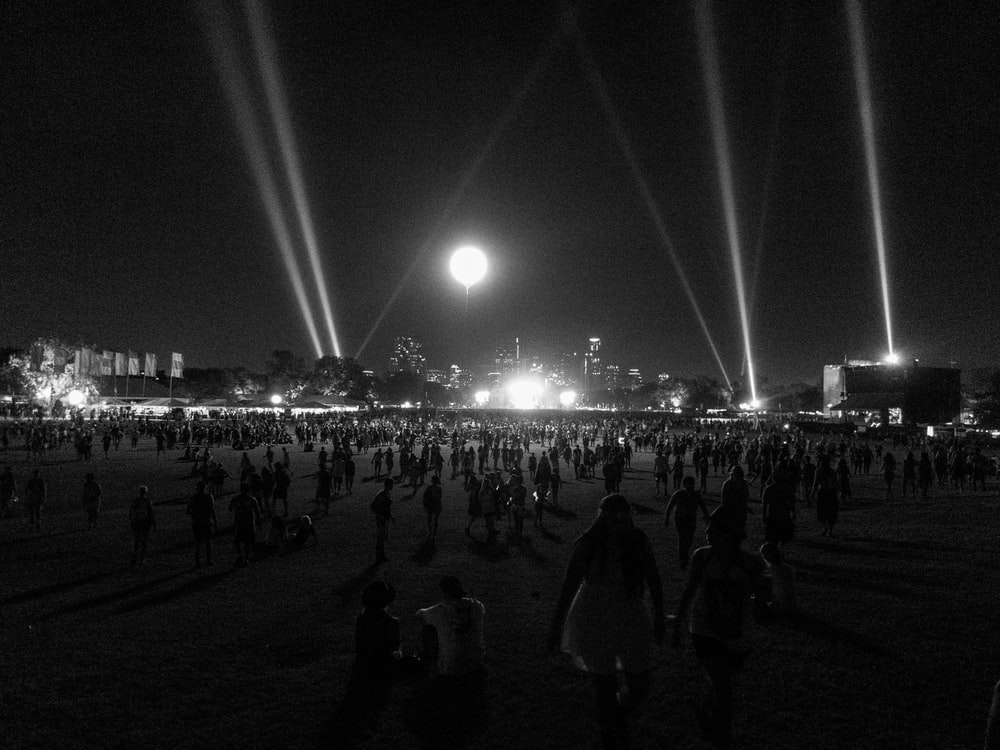 crowd of people in park at night