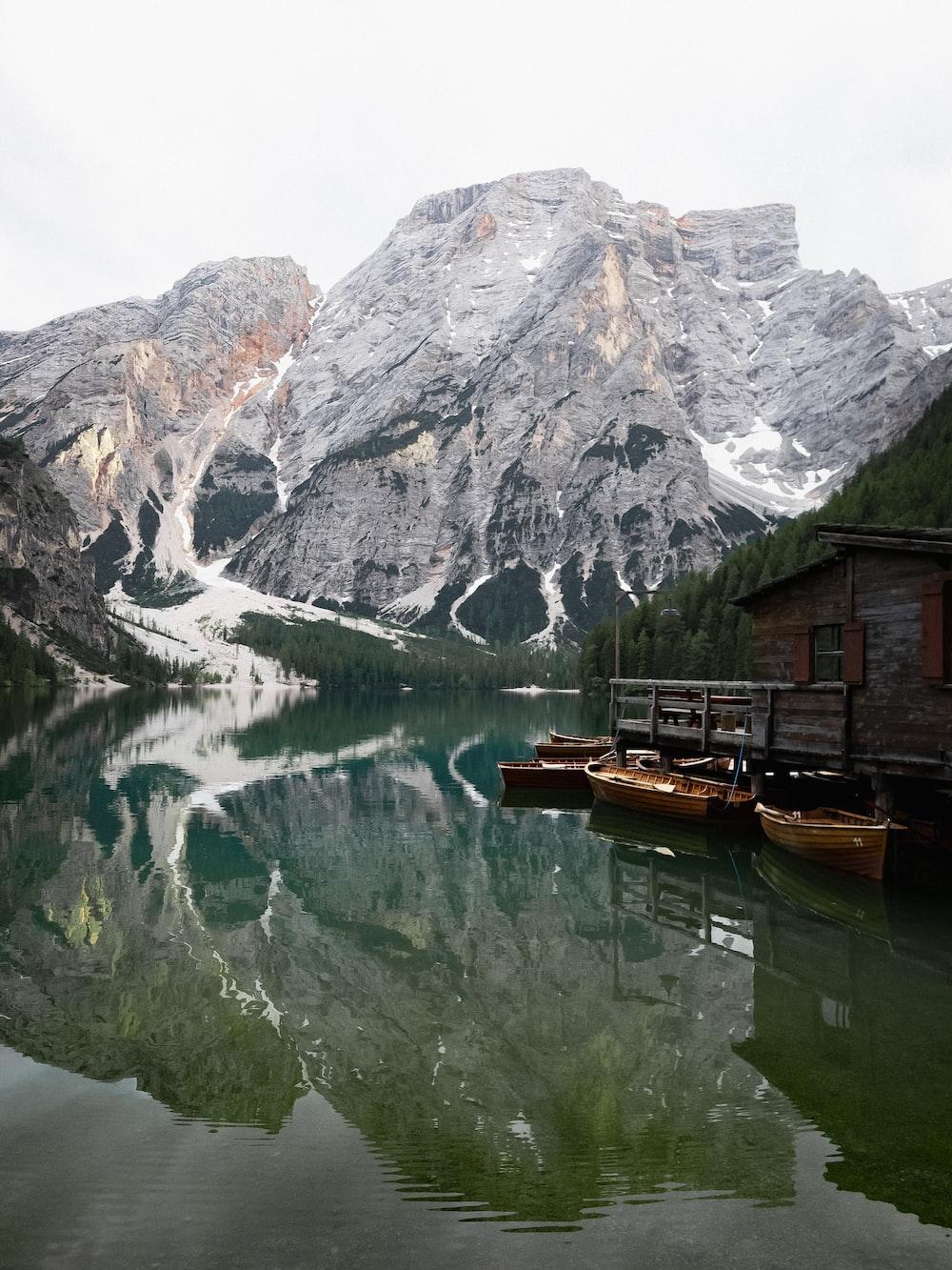 wooden house beside lake