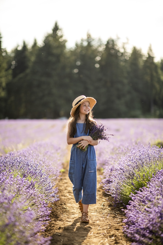 woman standing near lavender flowers