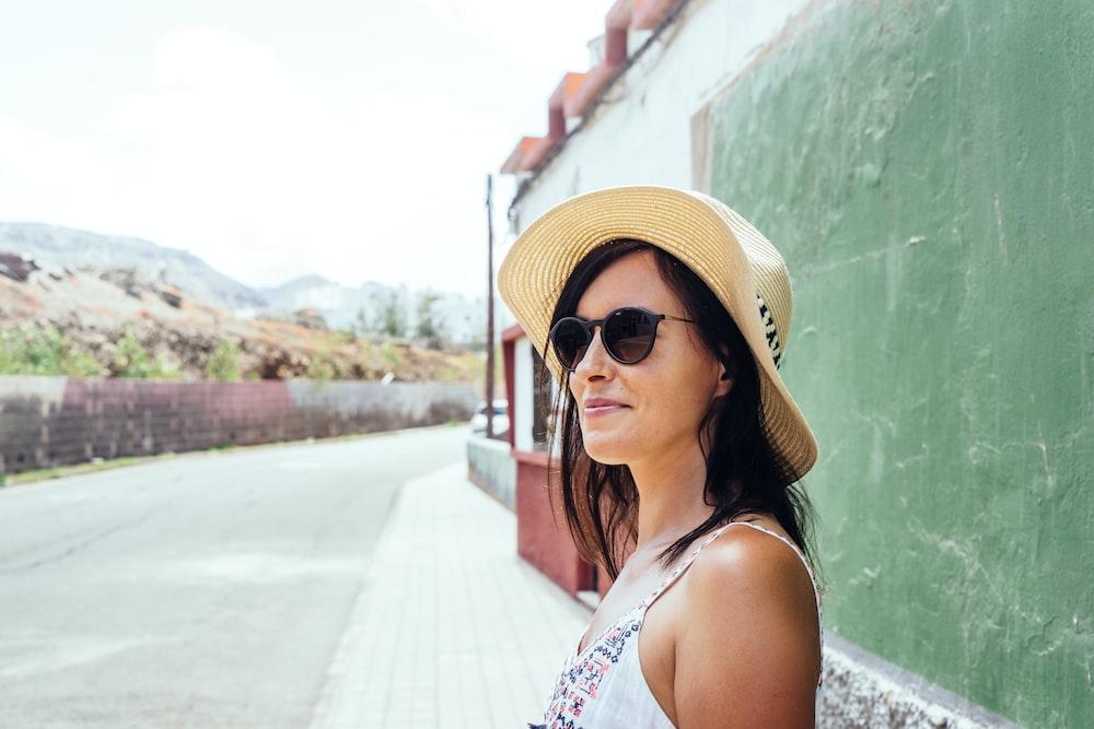 woman standing beside wall