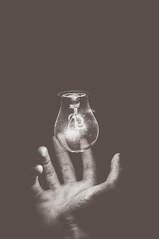 light bulb on grayscale photography