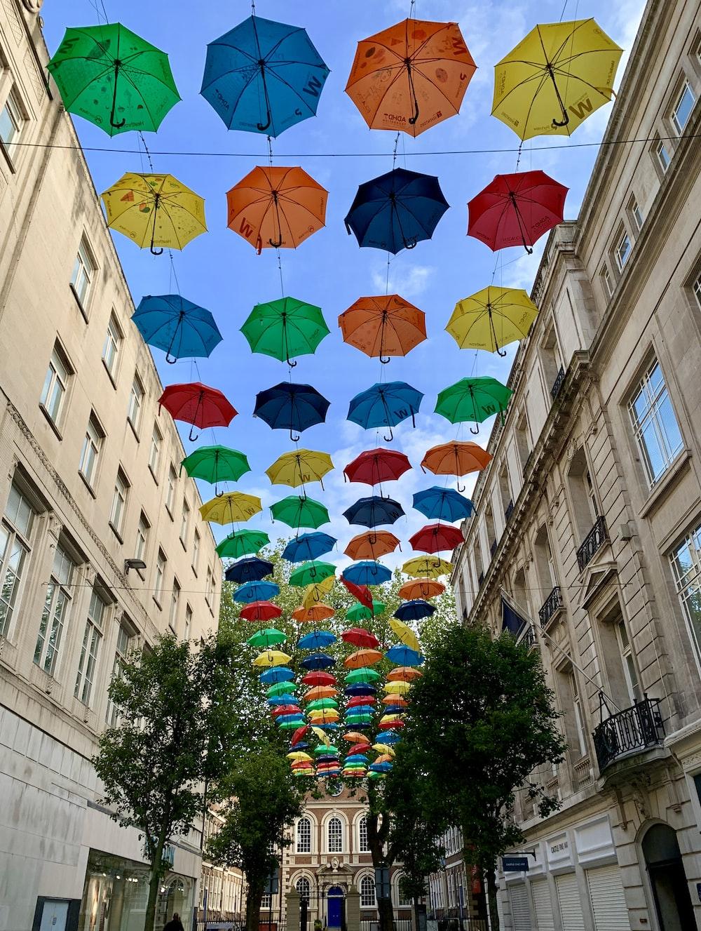 assorted-color umbrellas under blue sky