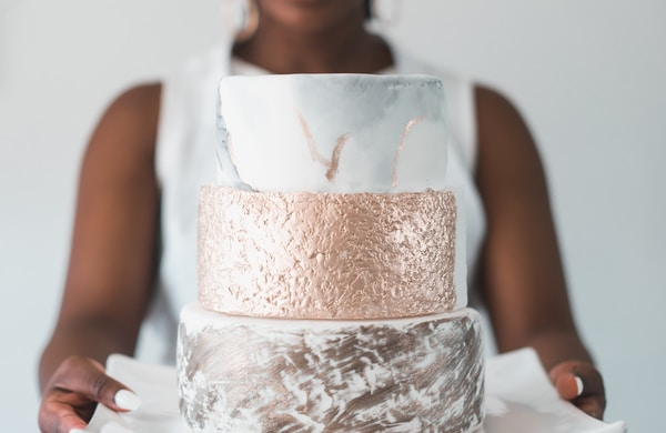 woman carrying cake