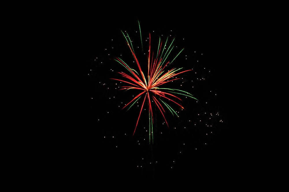 selective photography of red, green, and yellow fireworks