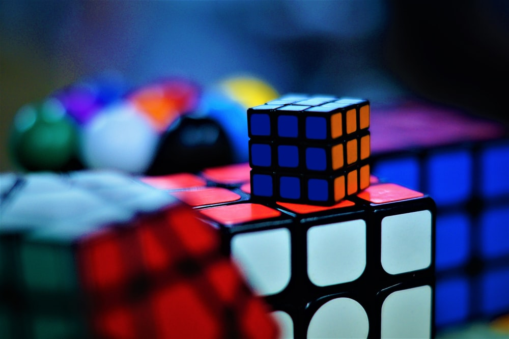 shallow focus photo of Rubik's cubes