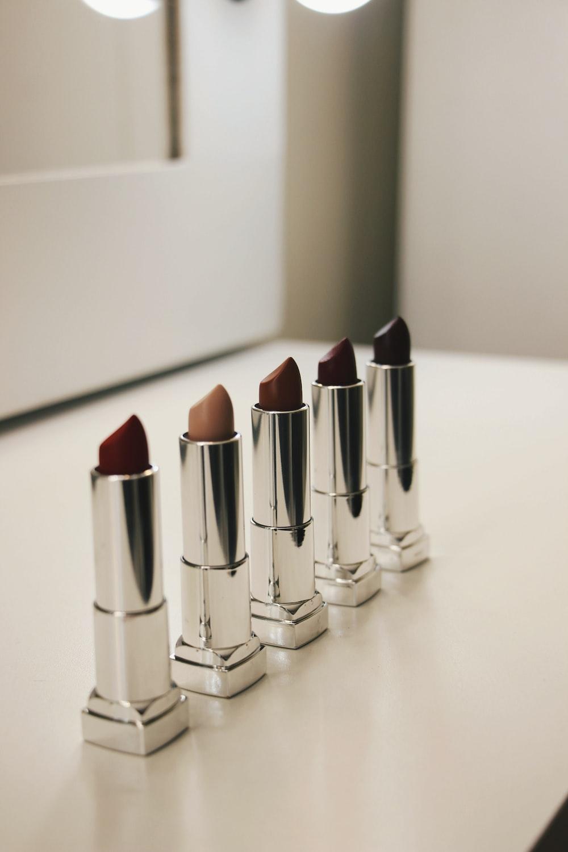 five assorted-color lipsticks