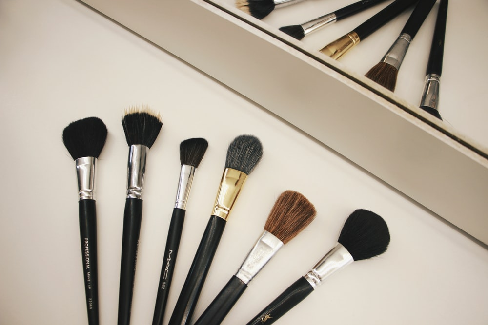 assorted-color makeup brushes