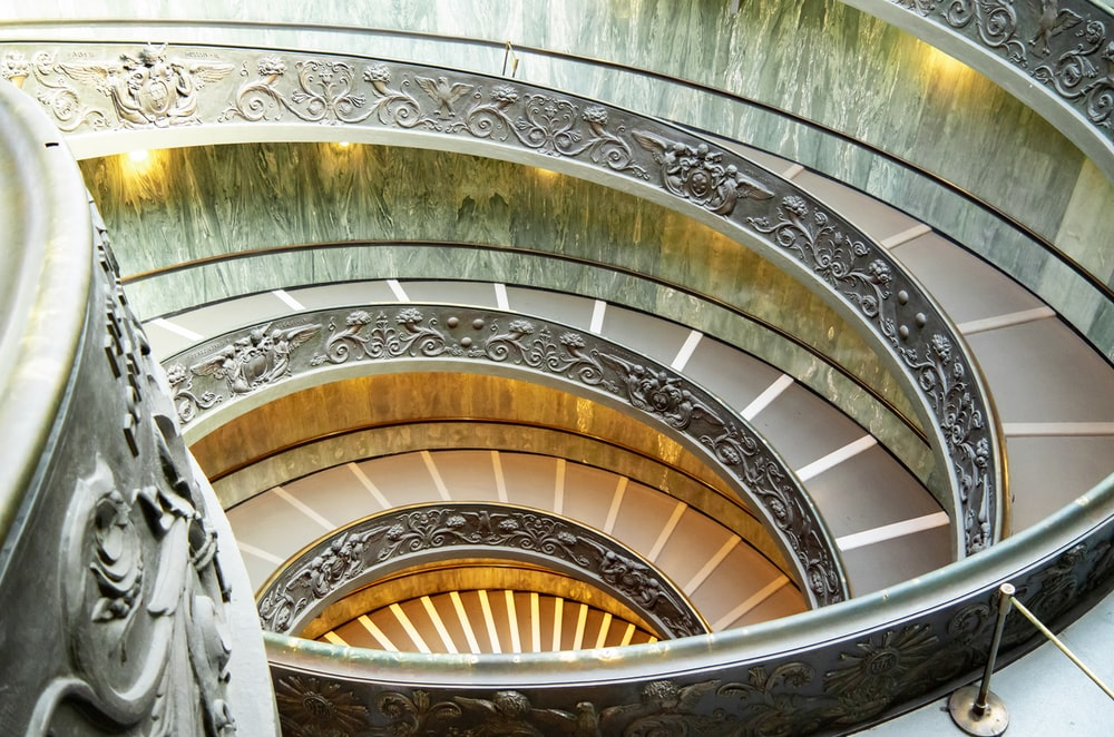 grey and brown spiral staircase
