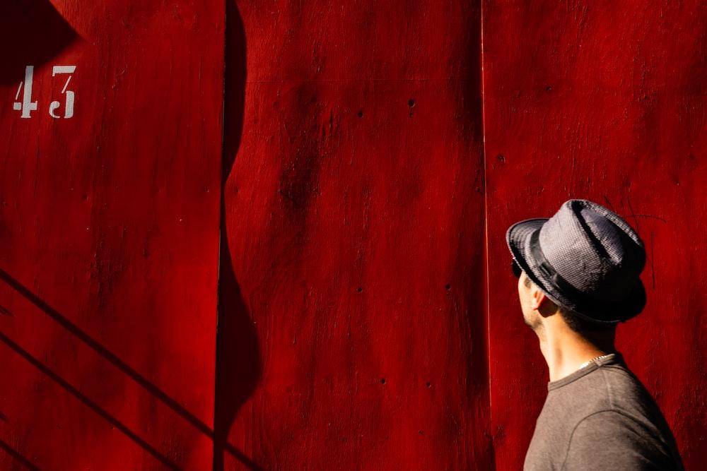 man near red tetxile