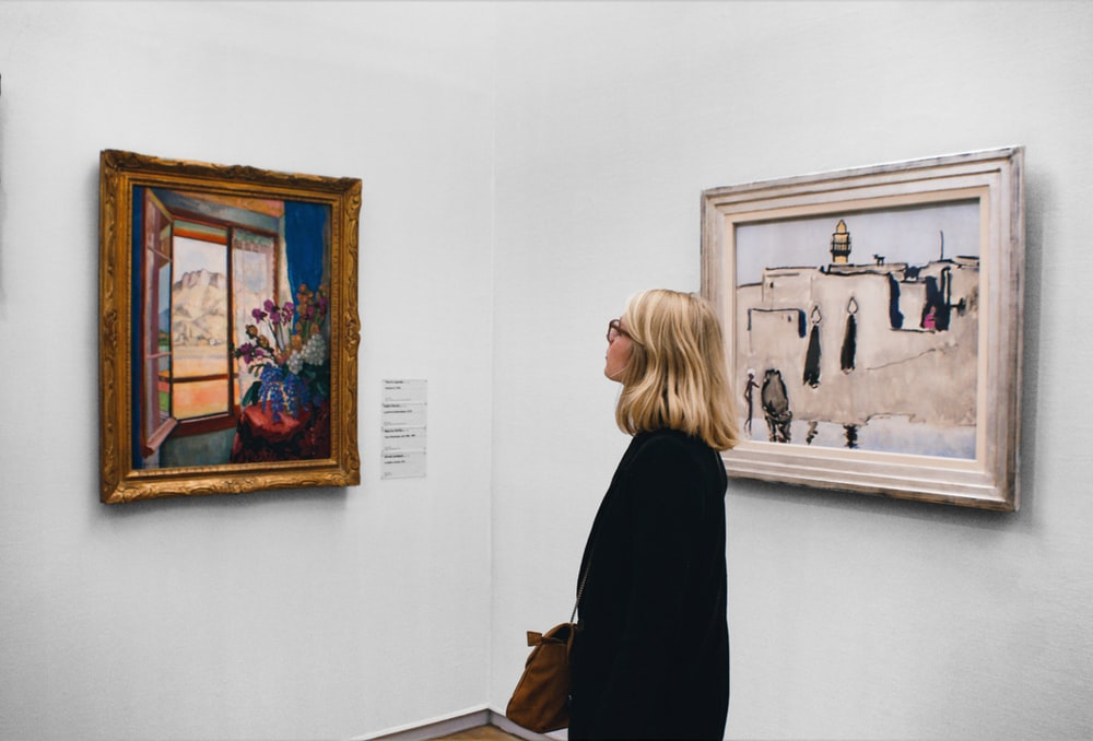 woman looking at painting