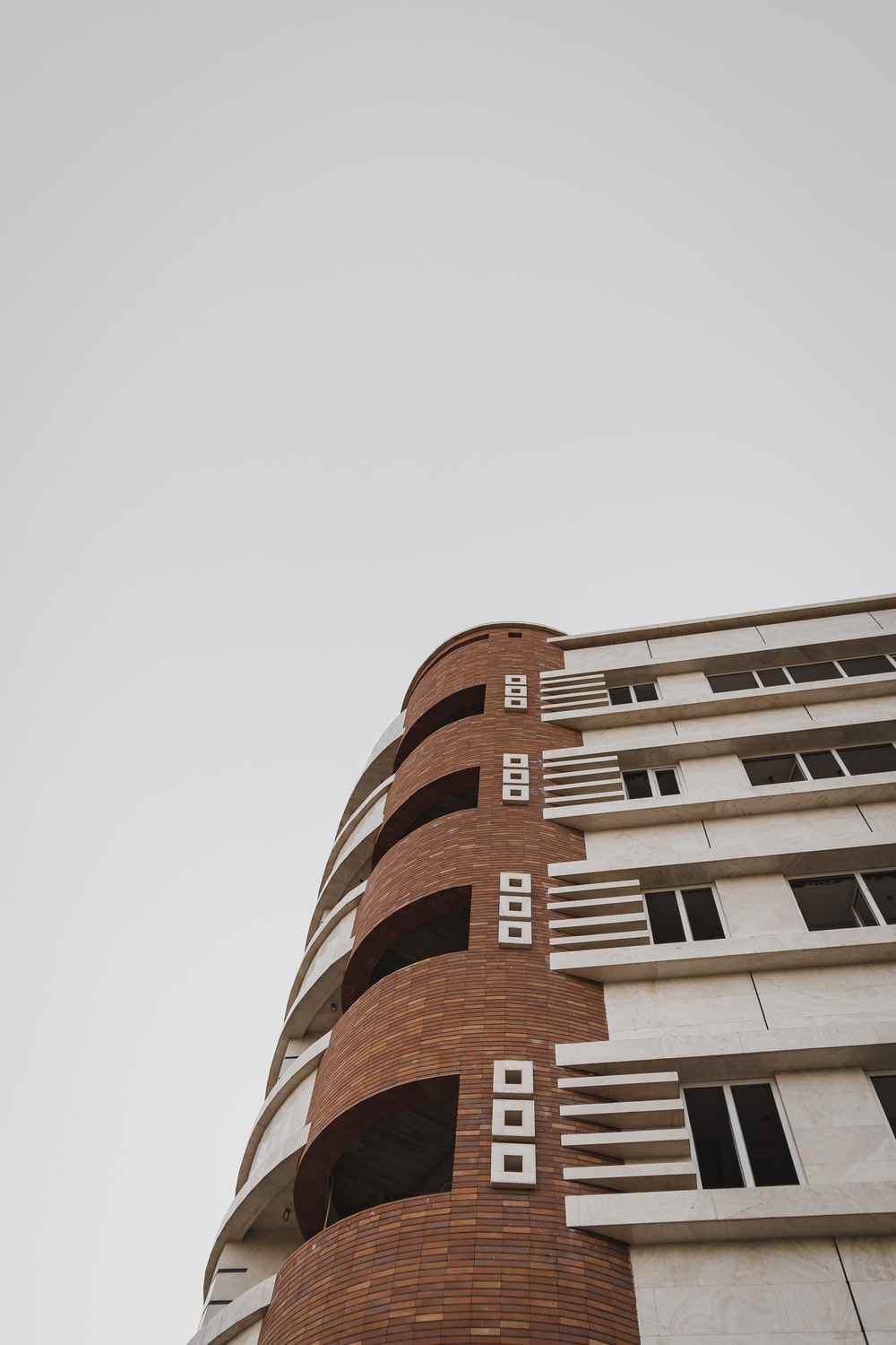low-angle photography of white and brown building