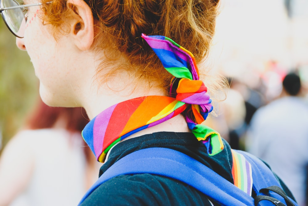 person wearing multicolored scarf