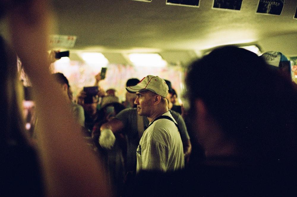 man wearing white shirt and white baseball cap