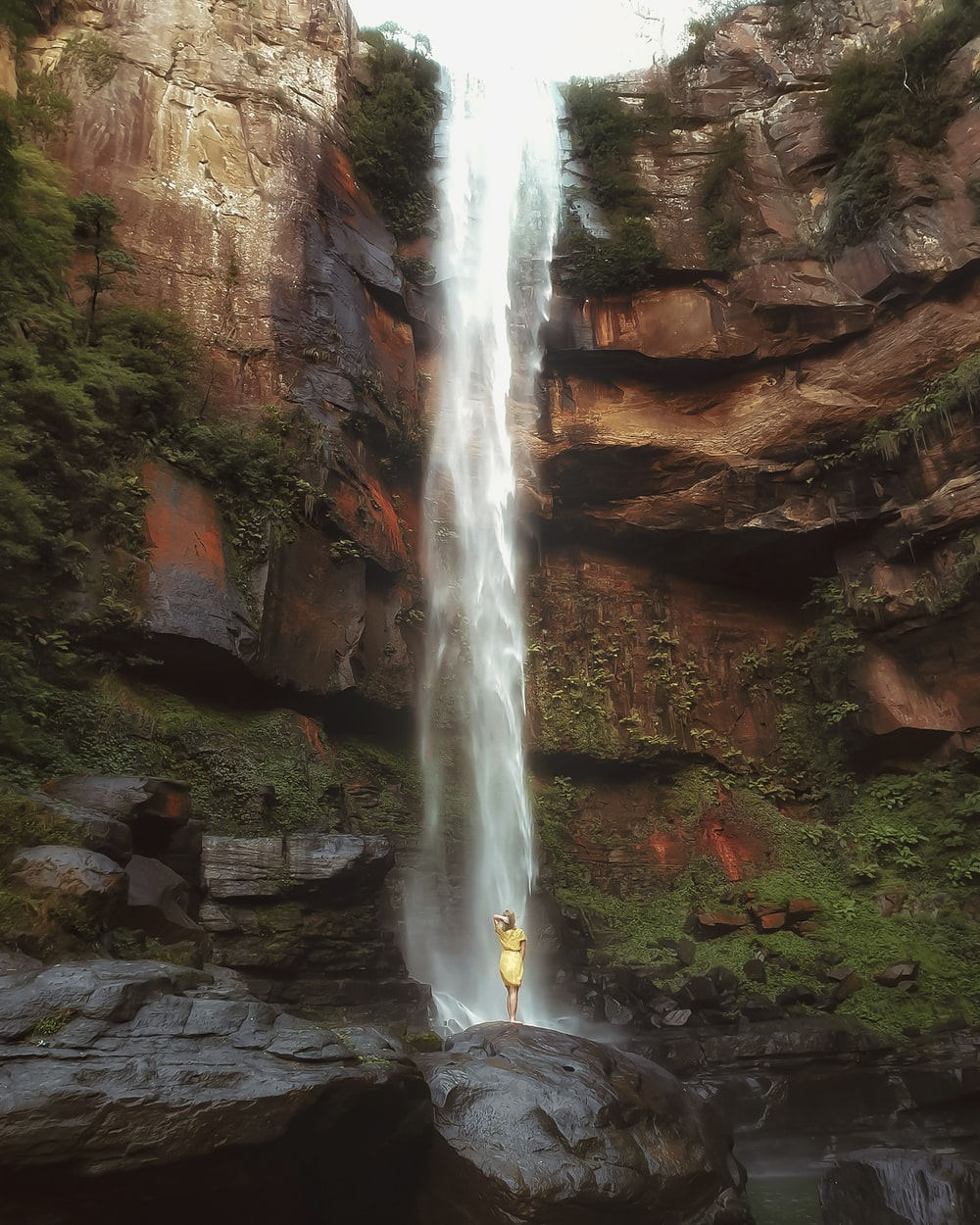 person on waterfall