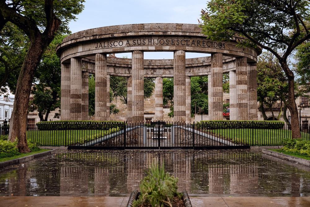 brown memorial near trees