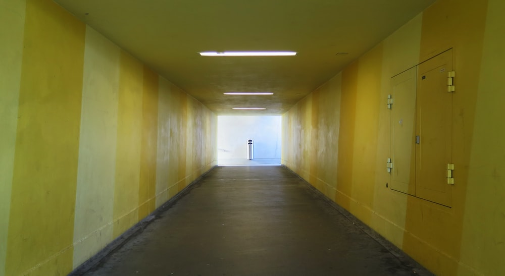 empty hallway with yellow painted wall