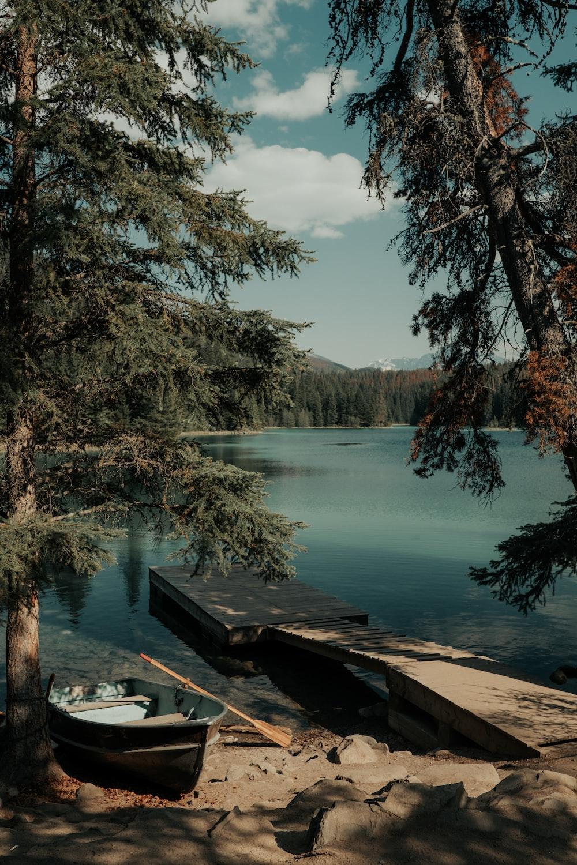 wooden boat and oar in lake dock