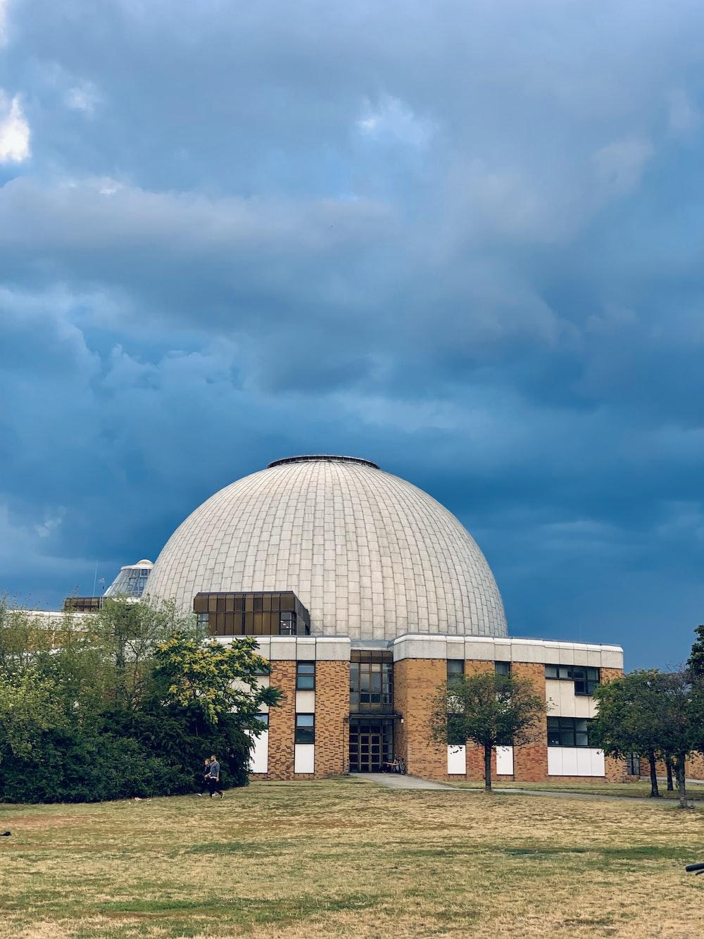 dome building under dark clouds