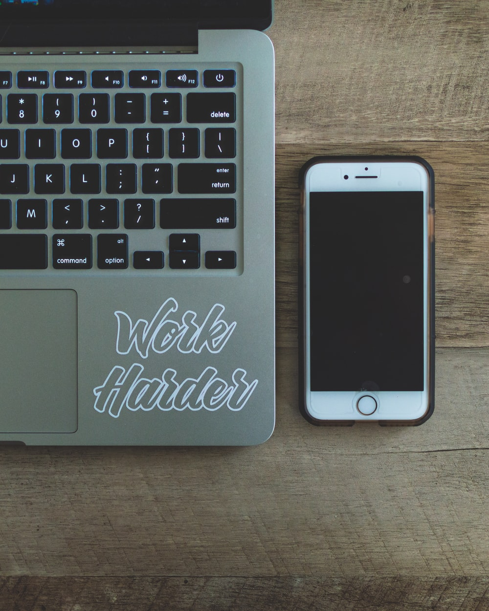 gray laptop near iPhone