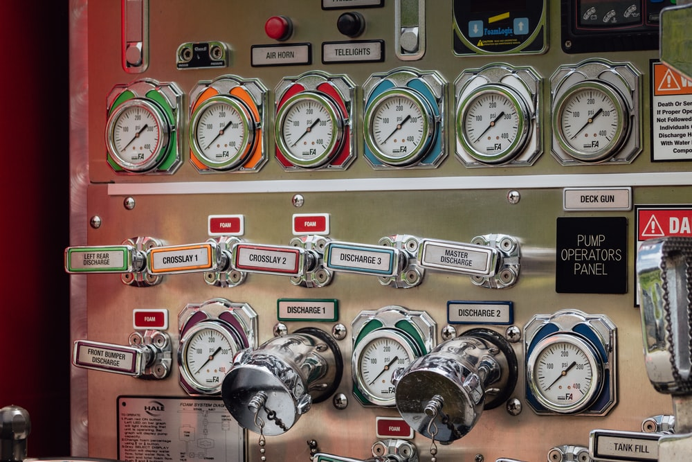gray and multicolored analog gauges