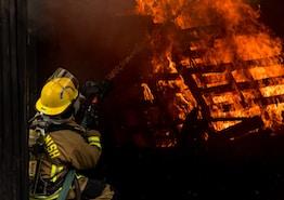 firefighter inside burning house