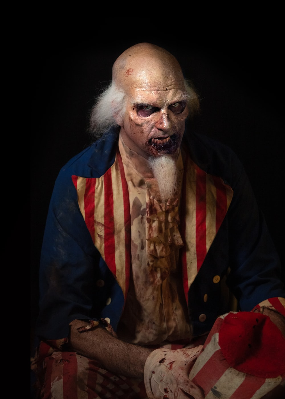 man in red, blue, and white coat horror character