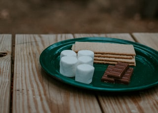 crackers and chocolates in round green ceramic plate