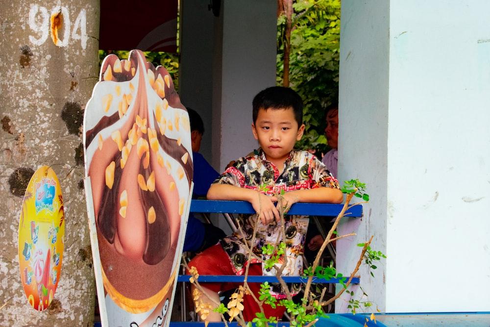 boy leaning on rail