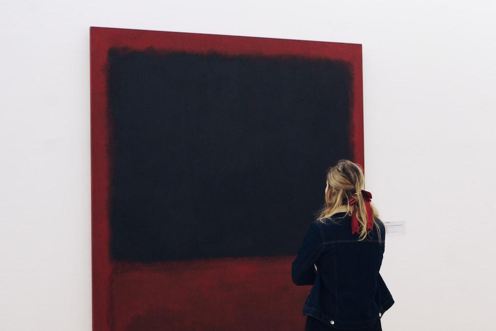 woman standing in front of blackboard