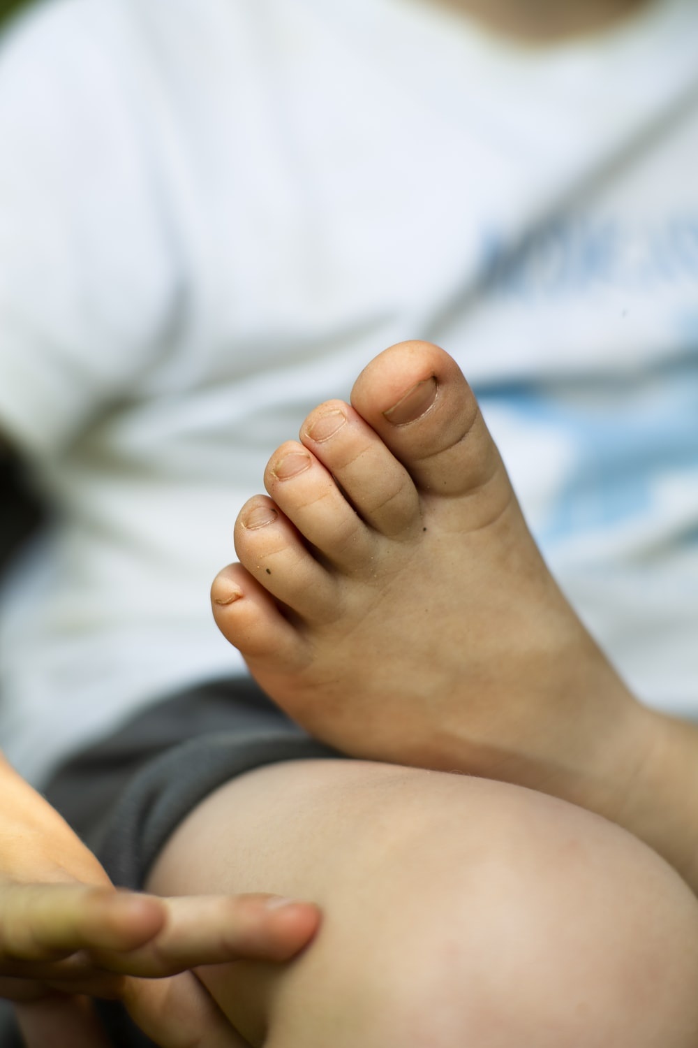 person putting left foot on lap of another person