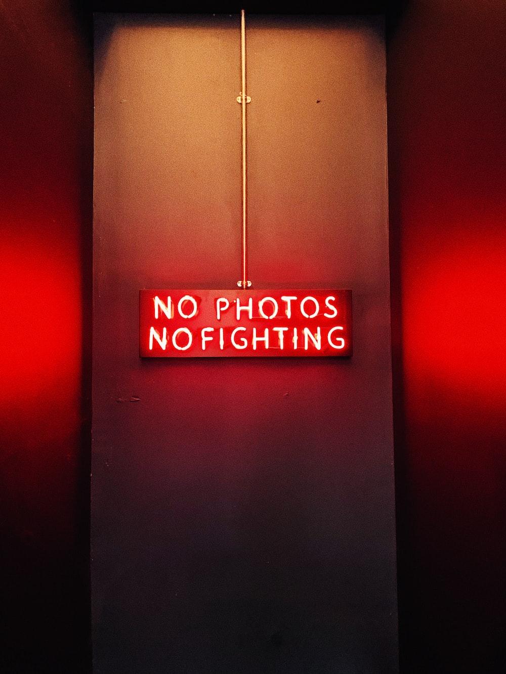 no photos no fighting signage