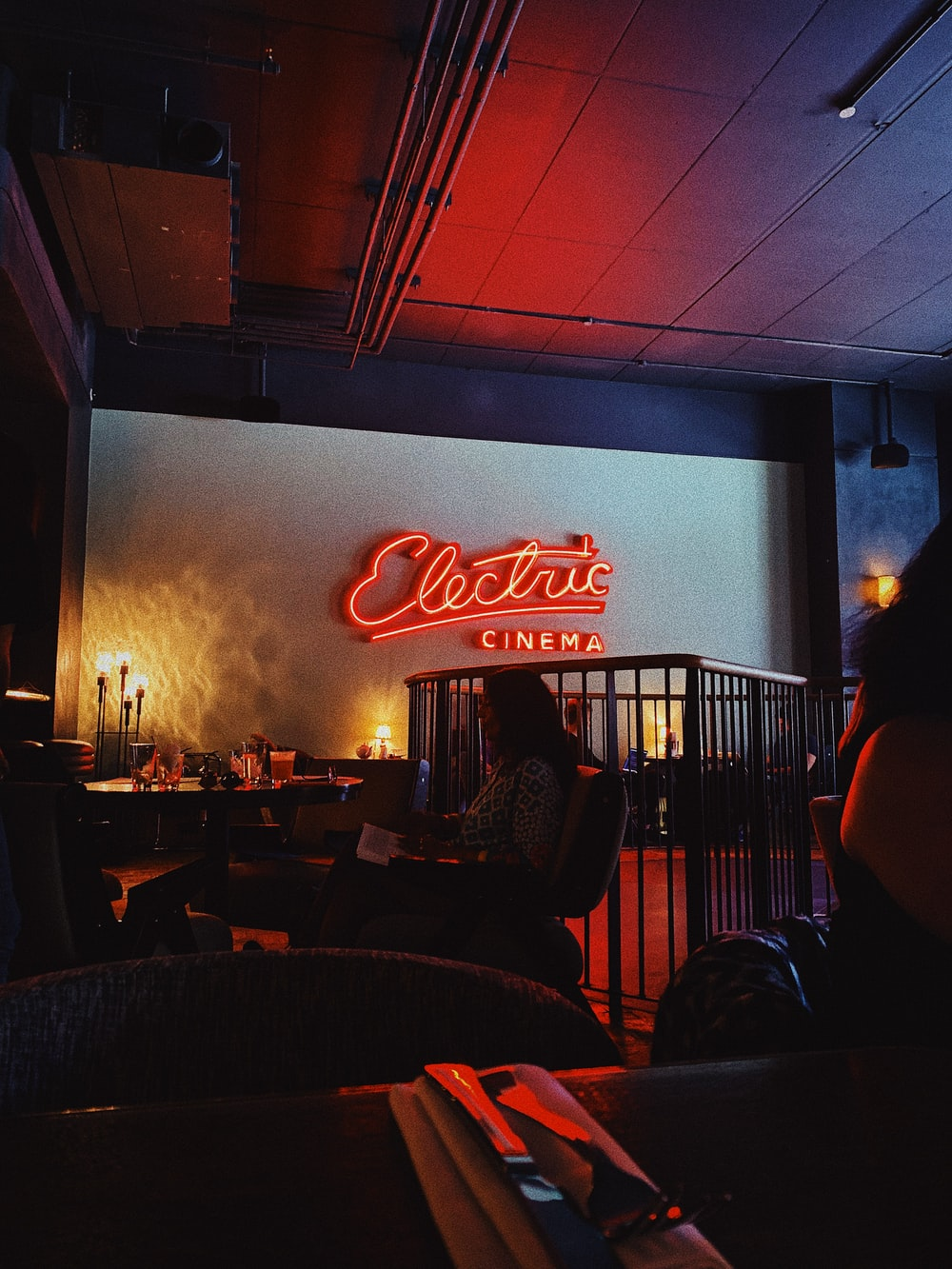 woman sitting near table inside electric cinema