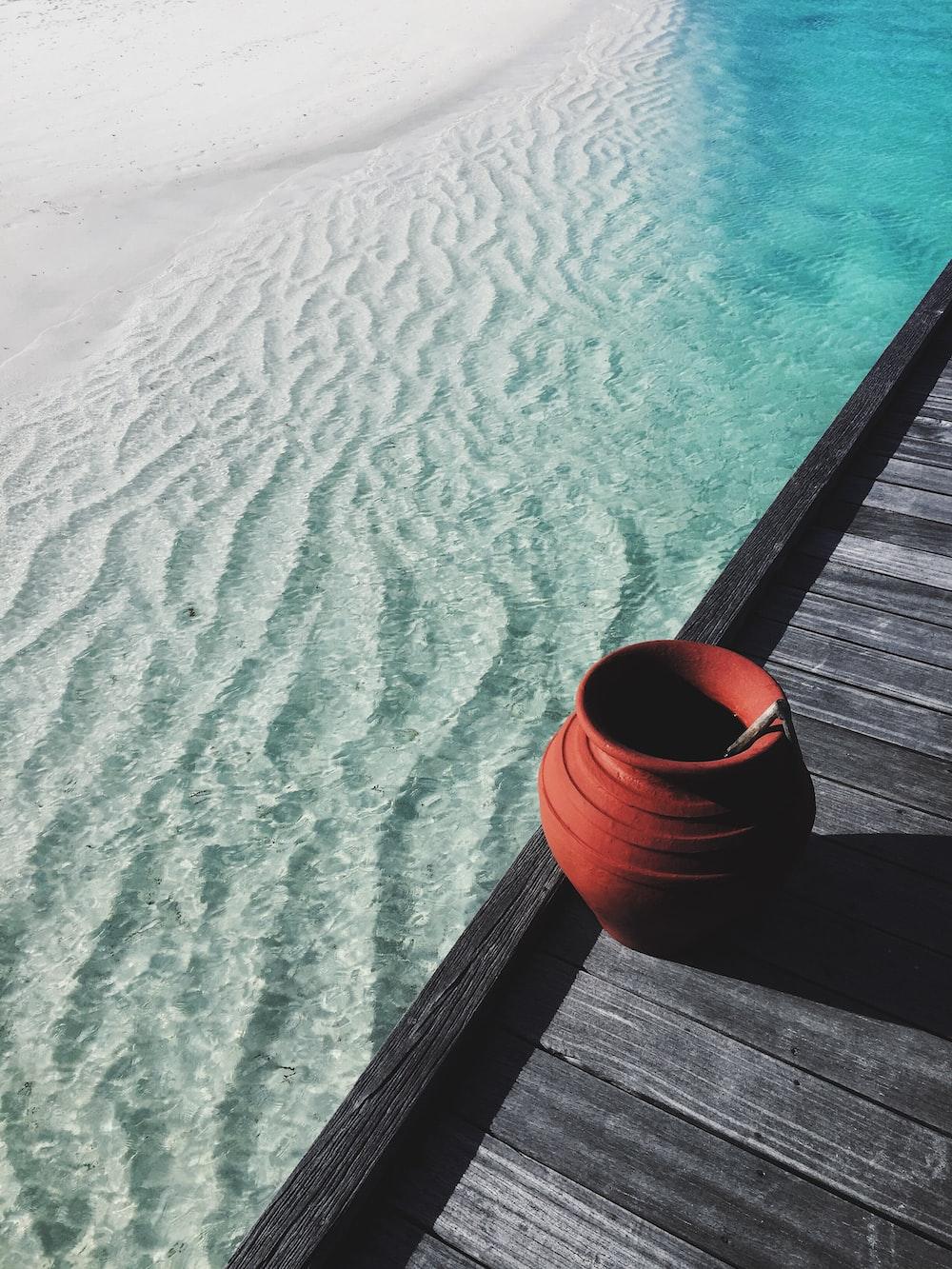 brown jar near water
