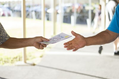 person holding card