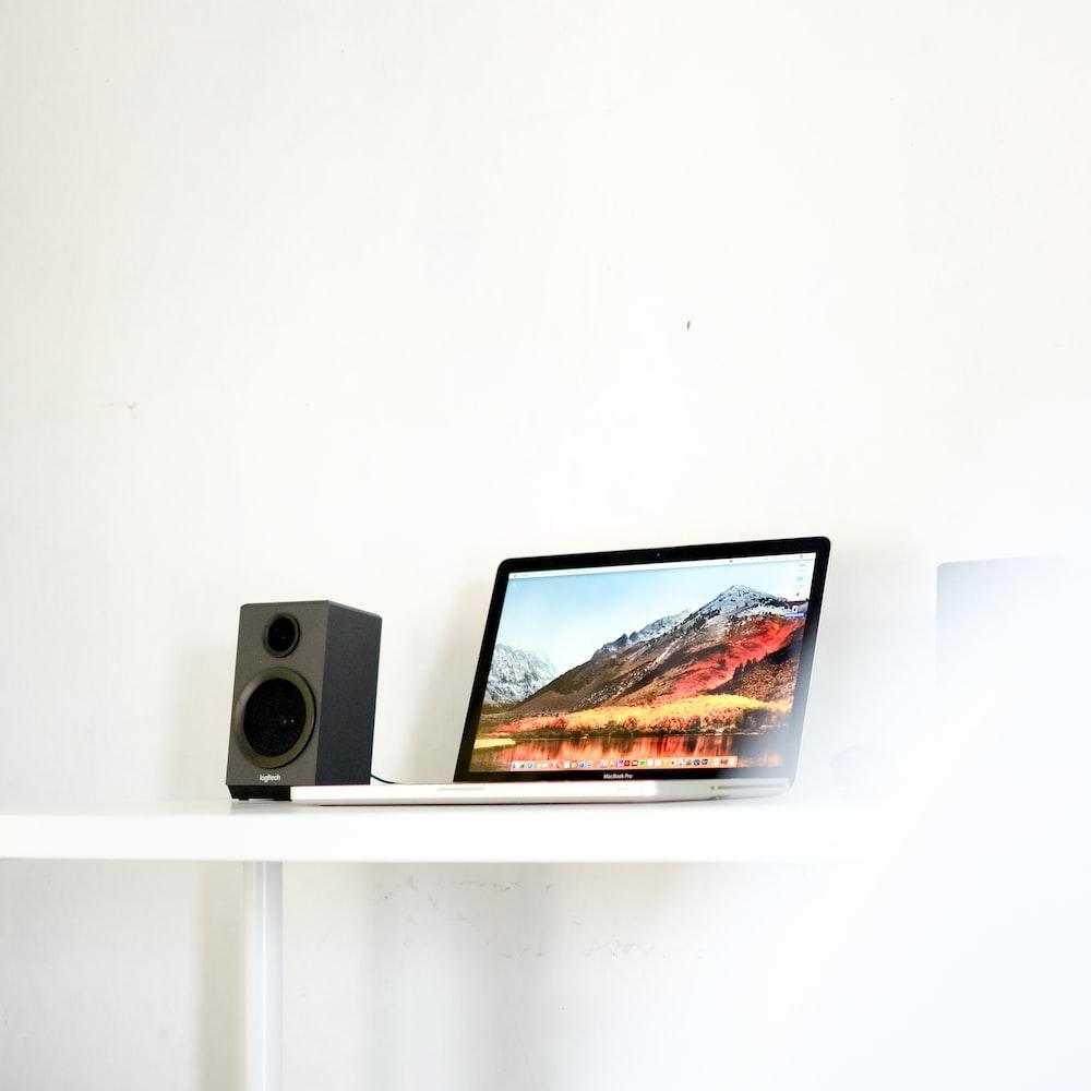 laptop beside speaker