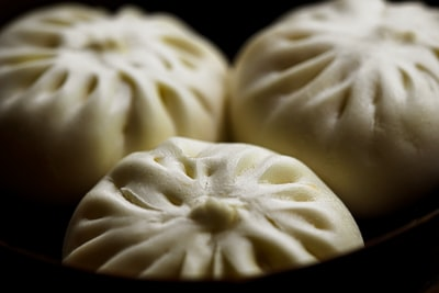 three steam buns dumpling teams background