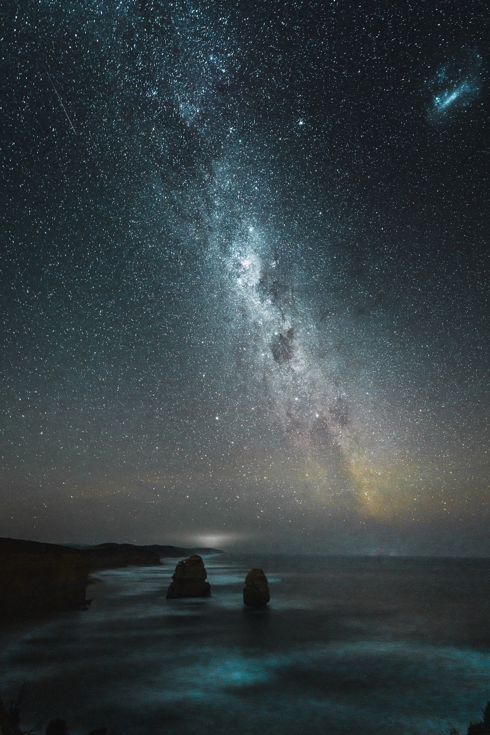 rock formation near shore during starry night