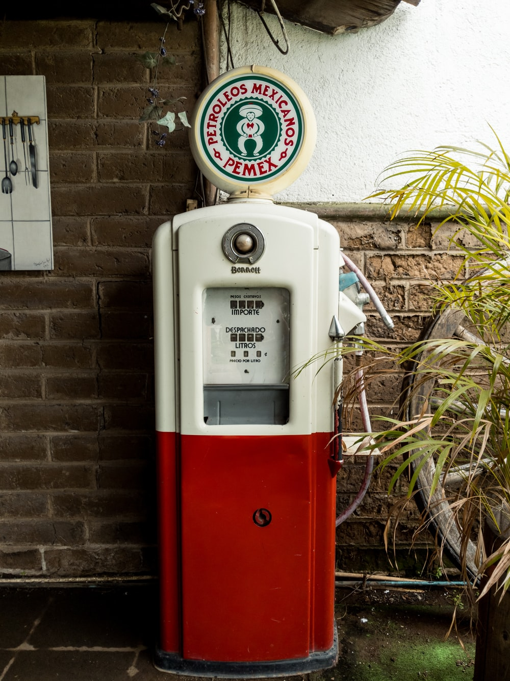 white and red gasoline pump