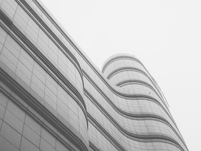 white and grey high rise building wavy teams background