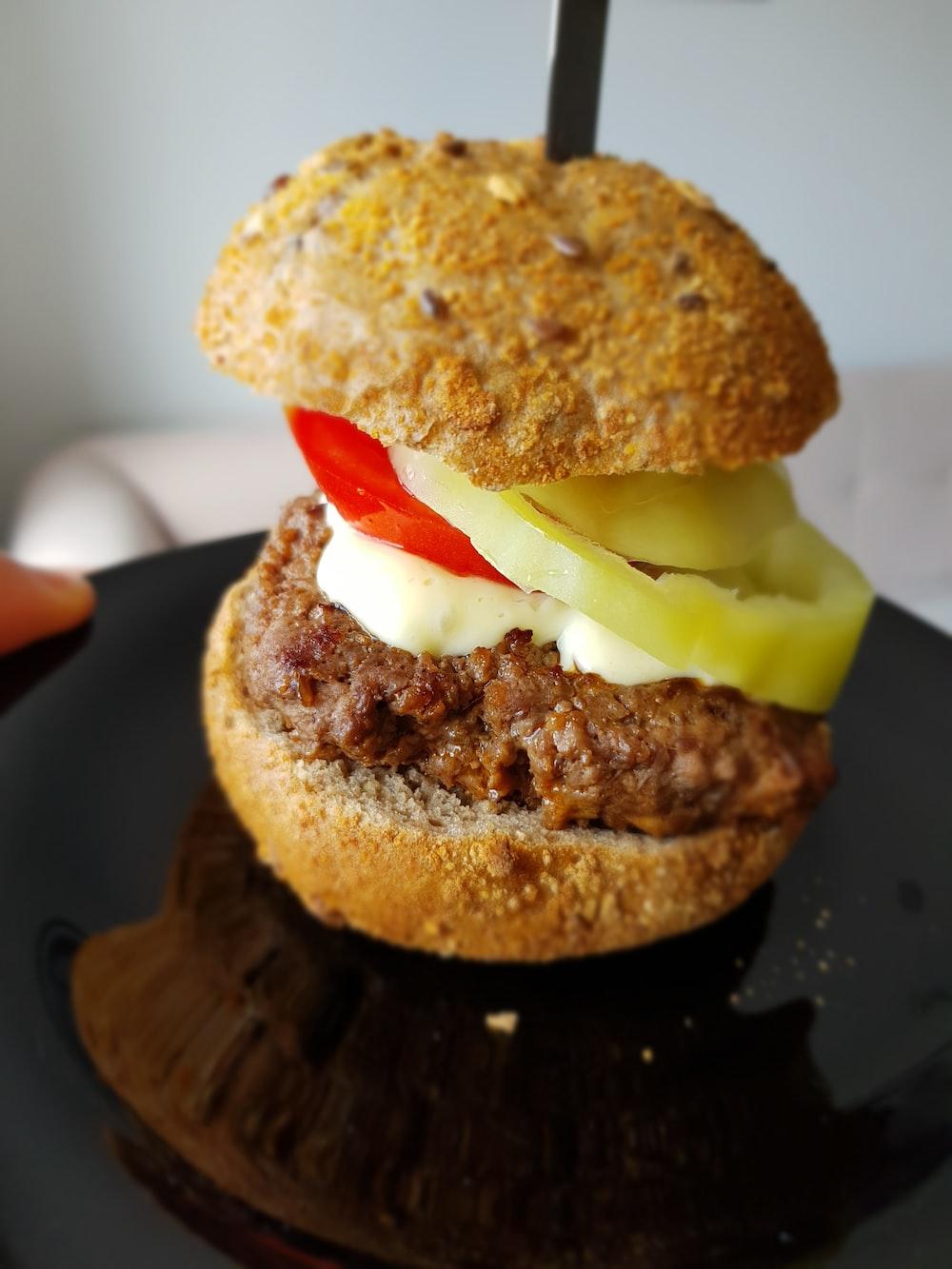 burger on black surface