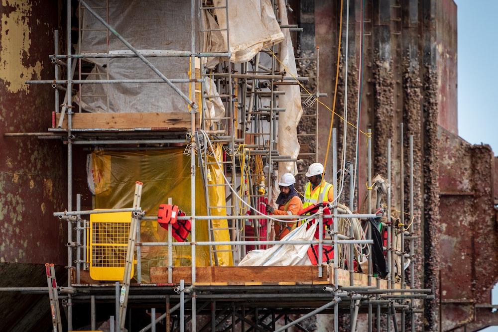 men on scaffolding