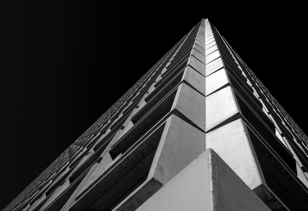 low-angle photo of white and black building
