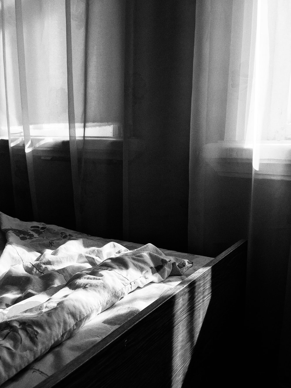 grayscale photography of curtain in room
