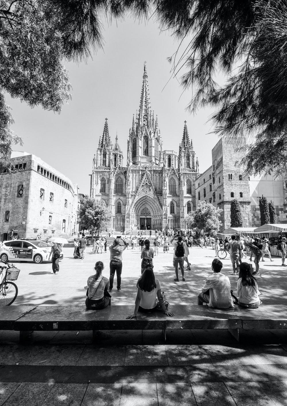 graysclae photo of people facing church