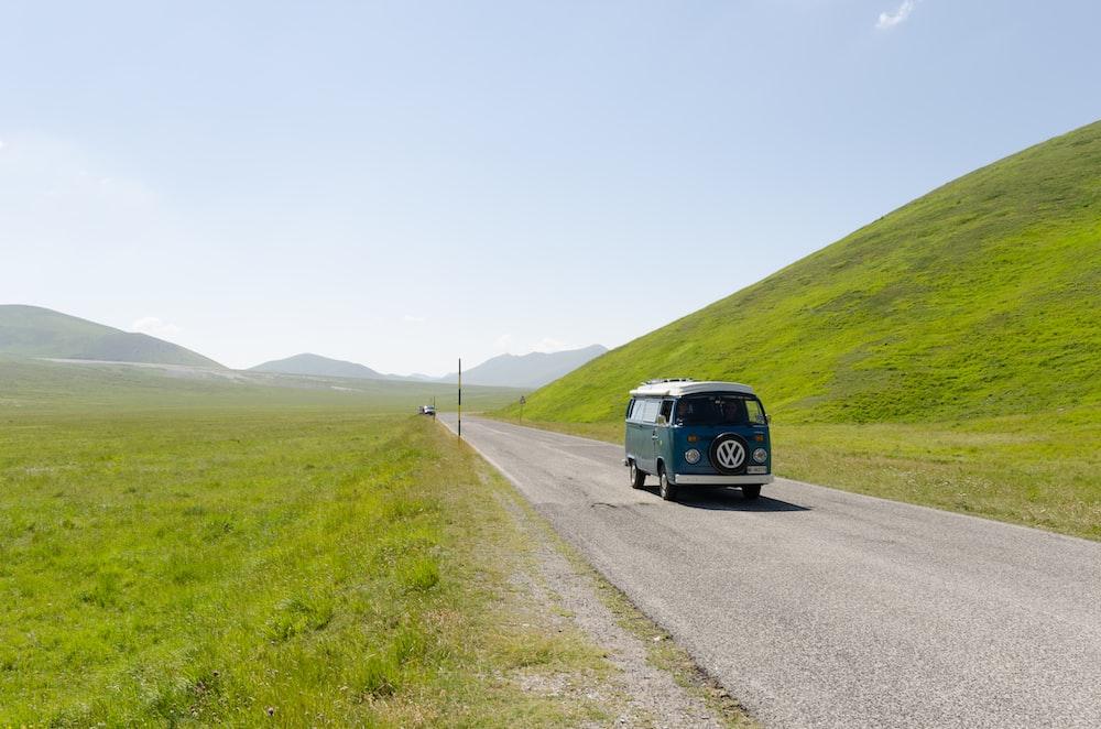 blue Volkswagen van on road