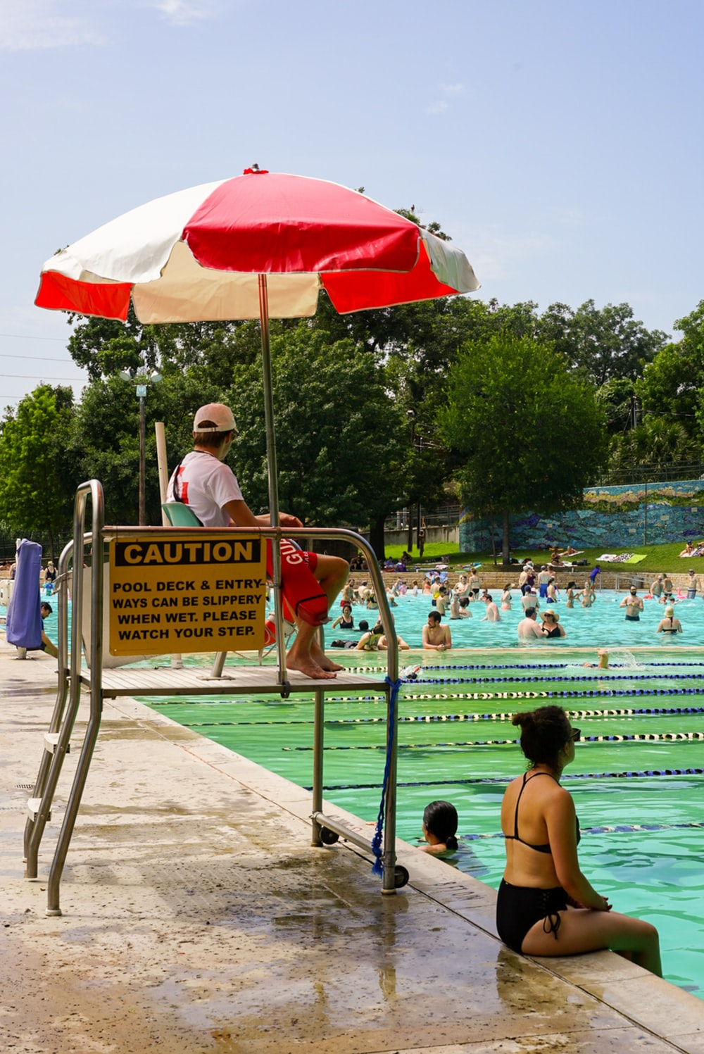 people swimming during daytime