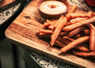 fries on brown wooden tray