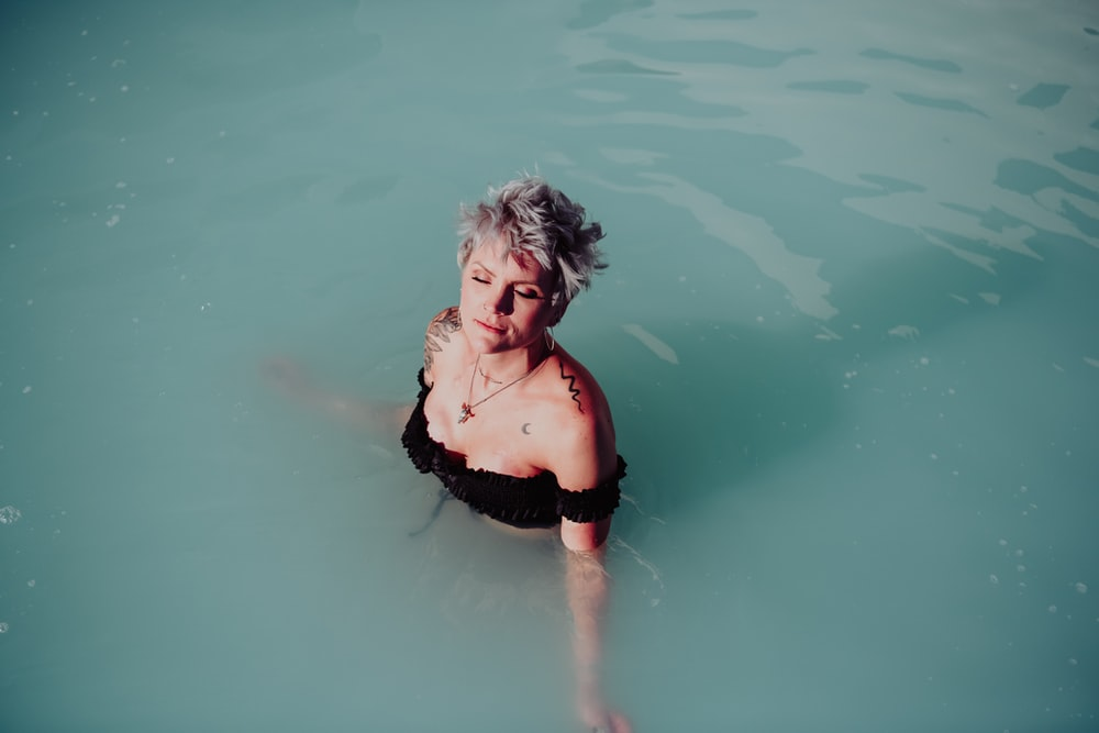 woman on body of water during daytime