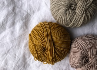 four assorted-color ball of yarns