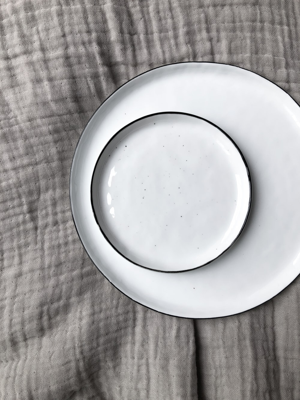 round white ceramic plate and saucer